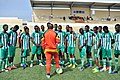 Somalia national team talks with coach Livingstone Mbabazi.jpg