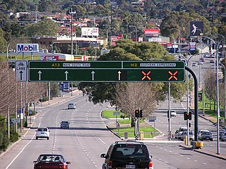 South Road, Adelaide - Main South Road approaching the northern junction with the Southern Expressway. The expressway was initially built as a single carriageway operating in the direction which would ease congestion on Main South Road. It reversed direction at midday and midnight.