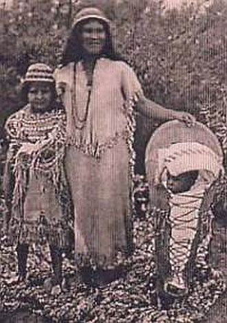 Housewife - Southern Paiutes at Moapa, Nevada, wearing traditional Paiute basket hats; note the Paiute cradleboard and rabbit robe