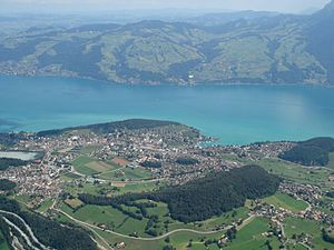 Spiez - Spiez from the air, with the lake in the background and the Kander bottom left