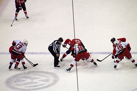 Sutter (centre foreground) taking a face-off against Dave Steckel, December 2009 Steckel and Sutter face off (4375663153).jpg