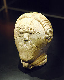 Stone head from mšecké žehrovice czech republic wearing a torc
