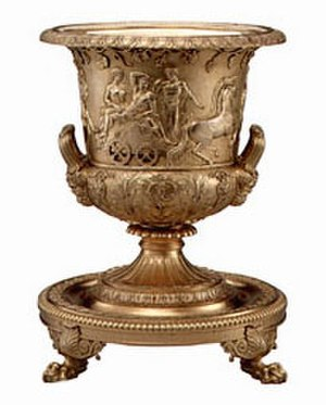 Silver-gilt - A vermeil wine cooler manufactured in 1810 by Paul Storr is located in the Vermeil Room of the White House.