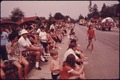 TOURISTS AND TOWNSPEOPLE LINE THE MAIN STREET OF HELEN GEORGIA, NEAR ROBERTSTOWN FOR THE FOURTH OF JULY PARADE. HELEN... - NARA - 557710.tif