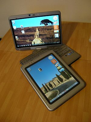 A convertible Tablet PC (HP Elitebook 2740p) a...