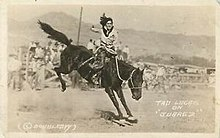 Tad-Lucas-Rodeo-Cowgirl-on-Bronco-c1920s-Doubleday-RPPC.jpg