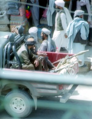 Islamic Emirate of Afghanistan - Taliban fighters patrolling the streets of Herat, 2001