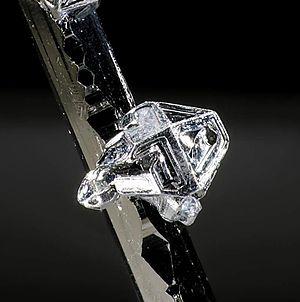 Tellurium - Native tellurium crystal on sylvanite (Vatukoula, Viti Levu, Fiji). Picture width 2 mm.