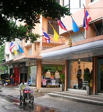 Royal flags of Thailand - Usual display of royal flags alternating with the flag of Thailand on a street in Bangkok