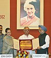 The Chairperson, National Advisory Council, Smt. Sonia Gandhi presenting the 27th Indira Gandhi National Integration Award to the Poet, Lyricist, Writer and Director, Shri Gulzar, at a function.jpg