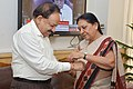 The Chief Minister of Gujarat, Smt. Anandiben Patel tying 'Rakhi' to the Union Minister for Health and Family Welfare, Dr. Harsh Vardhan, in New Delhi on August 08, 2014.jpg