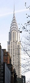 The Chrysler Building in Night New York City viewed from the Public Library.jpg