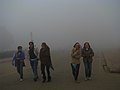 The Foreign Tourists visiting India Gate in dense fog in New Delhi on January 06, 2010.jpg