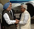 The Prime Minister, Dr. Manmohan Singh being received by the Chief Minister of West Bengal, Shri Buddhadeb Bhattacharjee, on his arrival at Netaji Subhash Chandra Bose International Airport, West Bengal on January 07, 2010.jpg