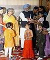 The children tying 'Rakhi' to the Prime Minister, Dr. Manmohan Singh, on the occasion of 'Raksha Bandhan', in New Delhi on August 16, 2008.jpg