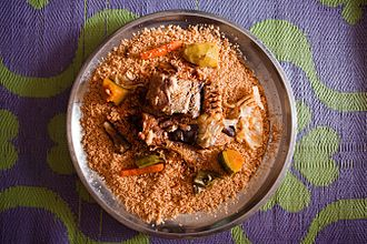 Broken rice - A thieboudienne from Mauritania, with tomato broken rice, fish, and vegetables.