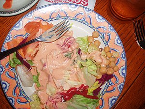 Thousand Island Dressing on a plate of salad. ...