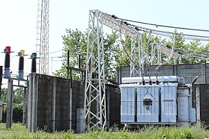 Three-phase electric power - Three-phase transformer (Békéscsaba, Hungary): on the left are the primary wires and on the right are the secondary wires