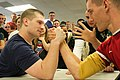 Two boys engaged in arm wrestling.jpg