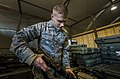 U.S. Air Force Staff Sgt. Jeremy Chandler, a weapons manager with the 376th Expeditionary Logistics Readiness Squadron, checks the serial number on a M24 rifle at Transit Center at Manas, Kyrgyzstan, Dec. 10 131210-F-VU439-020.jpg