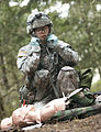 U.S. Army 2nd Lt. Diana Kim a platoon leader with 2nd Battalion, 2nd Infantry Division, uses a stethescope to check vital signs on a casualty as part of Expert Field Medical Badge qualification at Joint Base 130409-A-CD114-616.jpg