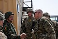 U.S. Army Maj. Gen. Paul J. LaCamera, right, the commanding general of the 4th Infantry Division and Regional Command (South), welcomes Afghan National Army (ANA) Gen. Mohammad Wardak, left, the ANA surgeon 130819-A-VM825-018.jpg