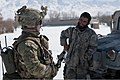 U.S. Army Sgt. Nicholas Fenton, left, with the Headquarters and Headquarters Company, 3rd Battalion, 509th Infantry Regiment, Task Force Spartan, greets a member of the Afghan Border Police during a patrol in 120216-A-ZU930-010.jpg