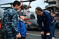 U.S. Navy Capt. Ronald Reis, the commanding officer of the aircraft carrier USS John C. Stennis (CVN 74), greets Culinary Specialist 3rd Class Chris Landrum and his brother Dylan Hanthorn during a dependents' 130427-N-TC437-320.jpg