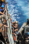 U.S. Sailors and Marines with the visit, board, search and seizure team, currently assigned to the guided missile cruiser USS San Jacinto (CG 56), climb onboard from a rigid hull inflatable boat, after 100524-N-EF447-261.jpg