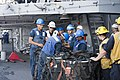 U.S. Sailors unload supplies aboard the guided missile cruiser USS Vella Gulf (CG 72) in the Mediterranean Sea Aug. 27, 2014, during a replenishment at sea with the fleet replenishment oiler USNS Leroy Grumman 140827-N-ZE250-054.jpg