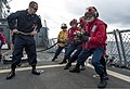 U.S. Sailors with a crash and salvage team move in on a simulated fire during a damage control drill on the flight deck of the guided missile destroyer USS Ross (DDG 71) in the Atlantic Ocean March 17, 2014 140317-N-WX580-047.jpg