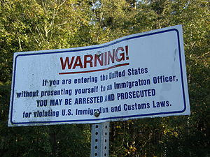 A sign at the international boundary between C...