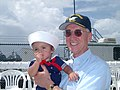 US Navy 020817-N-0000W-001 SECNAV holds child during USS Kennedy homecoming.jpg