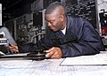 US Navy 030115-N-9109V-001 Quartermaster 3rd Class Richard Jones from Alexandria, La., plots a course.jpg
