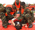 US Navy 030604-N-0000W-001 Members of Yokosuka's Special Medical Operations Response Team assist a simulated casualty during a helicopter crash training exercise.jpg