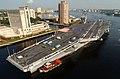 US Navy 030820-N-9851B-051 Tug boats guide USS Harry S. Truman (CVN 75) up the Elizabeth River, past Portsmouth landmarks, to the Norfolk Naval Shipyard.jpg