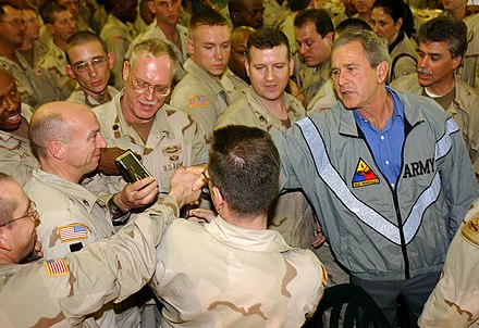 President Bush paying a surprise visit to Baghdad International Airport, November 27, 2003 US Navy 031127-F-5435R-006 President George W. Bush pays a surprise visit to Baghdad International Airport (BIAP).jpg