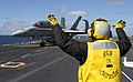 US Navy 040209-N-6713R-004 Aviation Boatswain's Mate 2nd Class Rudy Oliva from San Antonio, Texas, carefully directs an F-A-18C Hornet.jpg