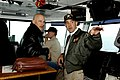 US Navy 040618-N-6817C-090 Director Rob Cohen visits with Commanding Officer, USS Abraham Lincoln (CVN 72), Capt. Kendall L. Card, on the bridge after the completion of filming, the upcoming motion picture Stealth.jpg