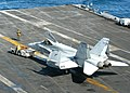 "US Navy 040701-N-7408M-048 Aviation Boatswain's Mates move an F-A-18 Hornet assigned to the ""Sidewinders"" of Strike Fighter Squadron Eight Six (VFA-86) across the flight deck of USS Enterprise (CVN 65).jpg"