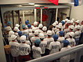 US Navy 040924-N-0000B-001 Boston area Naval Reserve Officer Training Corps (NROTC) members listen to a briefing at the USS Buttercup damage control wet trainer at Naval Station Newport, R.I., during Midshipmen Orientation.jpg