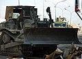 US Navy 041118-N-4388F-002 Equipment Operator 3rd Class Gerry Walker operates a Hi-Tracked bulldozer to clear debris from the streets of Fallujah, Iraq during Operation Al Fajr (New Dawn).jpg