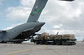 US Navy 050109-N-4267W-057 Seabees assigned to Naval Mobile Construction Battalion Seven (NMCB-7) load equipment and supplies onto a U.S. Air Force C-17.jpg