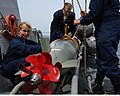 US Navy 050418-N-5526M-018 Sonar Technicians Renee Callie, left, and Scott Burdick help guide a MK-46 Mod 5A torpedo out of the launching tube.jpg