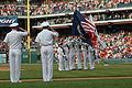 US Navy 050701-N-9395D-005 U.S. Navy color guard assigned to the Arleigh Burke-class guided missile destroyer USS Cole (DDG 67), present the colors during the playing of the National Anthem.jpg