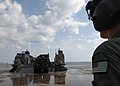US Navy 050906-N-4374S-007 A U.S. Marine Corps 7-ton truck is offloaded from a U.S. Navy Landing Craft, Air Cushion (LCAC) on a beach near Biloxi, Miss., in support of Hurricane Katrina relief efforts.jpg