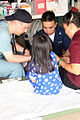 US Navy 050918-N-0780W-006 U.S. Navy Hospital Corpsman Vin Le, assigned to the Military Sealift Command (MSC) hospital ship USNS Comfort (T-AH 20), translates for a young patient at a makeshift clinic.jpg