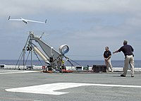 US Navy 060823-N-8547M-040 An Unmanned Aerial Vehicle (UAV) called Scan Eagle launches from a pneumatic wedge catapult launcher.jpg