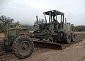 US Navy 061212-N-3560G-045 Equipment Operator 3rd Class Hyden Coleman of Naval Mobile Construction Battalion Four (NMCB-4) operates a grader during the Rapid Runway Repair (RRR) exercise during the field exercise Operation Bear.jpg