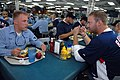 US Navy 070501-N-3659B-245 Aviation Electronics Technician 3rd Class Erick Bloom eats lunch with Washington Nationals' pitcher Jon Rauch on the mess decks of USS Ronald Reagan (CVN 76).jpg